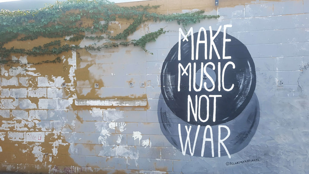 A guide to the best photo spots in Nashville by My Meraki Travel. Make music not war mural